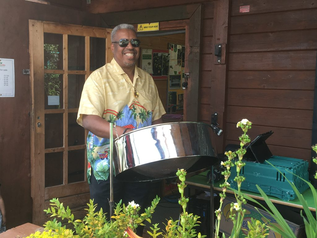 A volunteer plays the steel drums at our Windrush celebrations