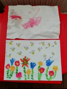 Finger painting of bees for Blooming Well activity