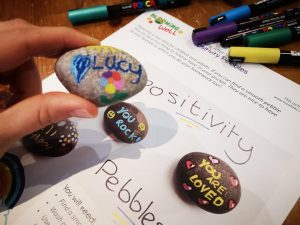 happy messages on a positivity pebble for blooming well