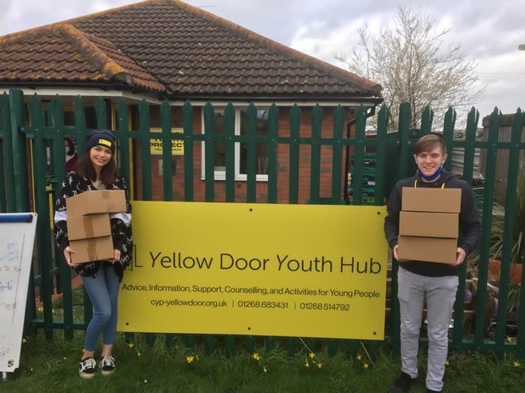 Yellow Door Youth Hub smiling with their food for thought boxes