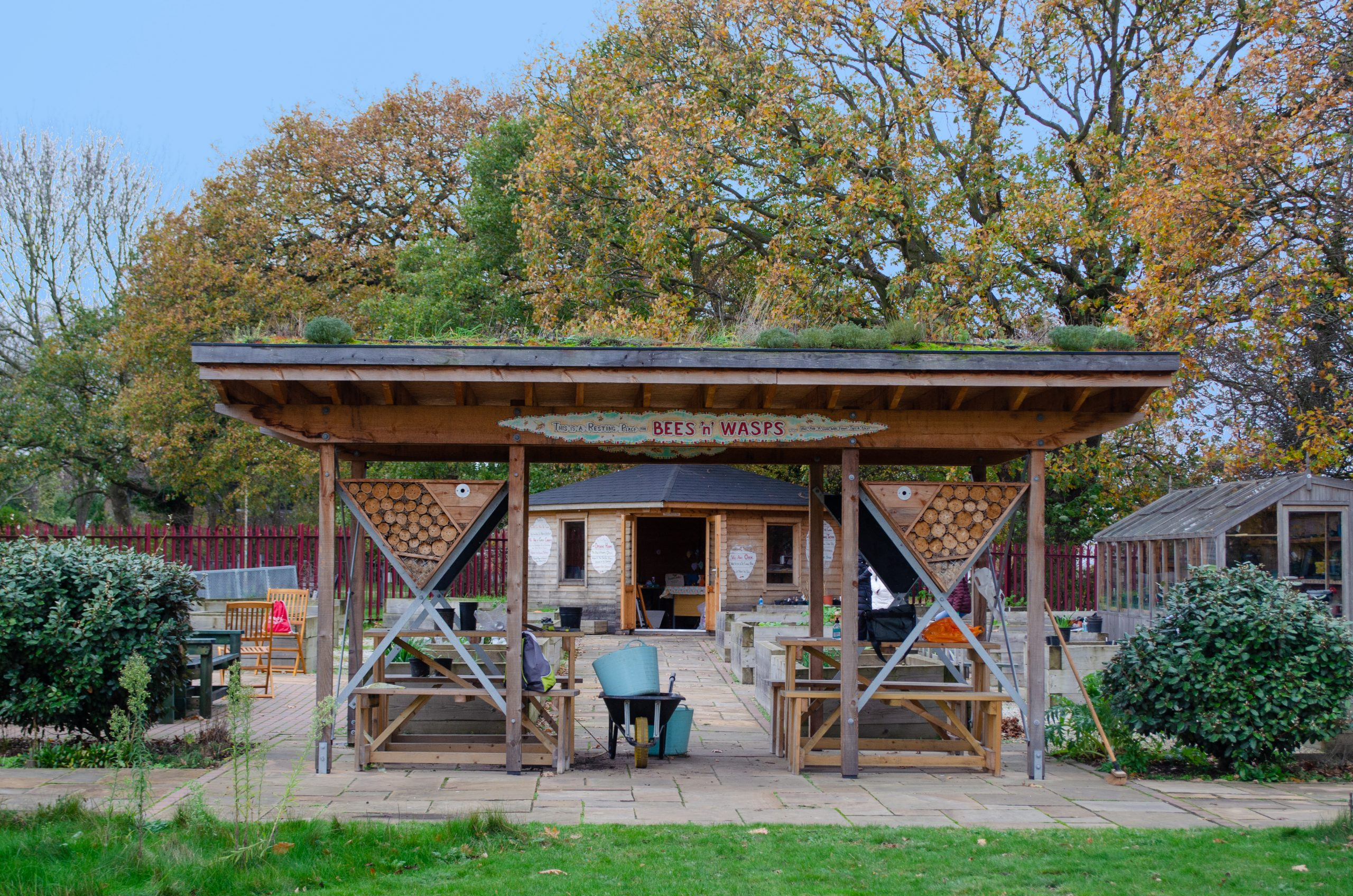 A sheltered seating area, which uses a green roof and bug hotels at Growing Together Thundersley